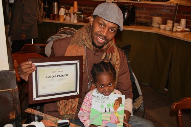 Liberated Muse heART Awardee Kuroji Patrick and his daughter Zamora Muse.
